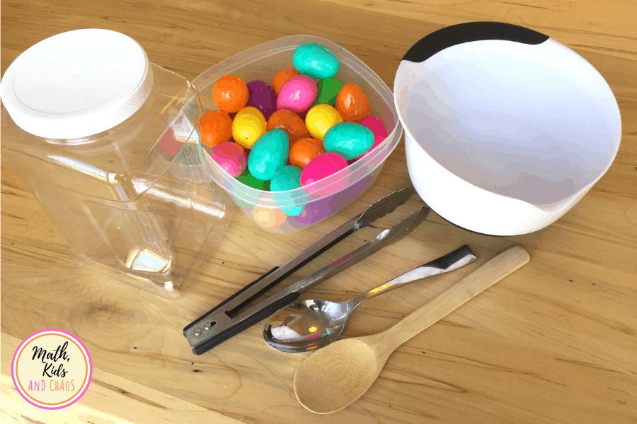 plastic easter eggs, jar, bowl, tongs, wooden spoon and metal spoon