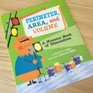 Perimeter, Area and Volume: a Monster Book of Dimensions by David A Adler and Edward Miller.