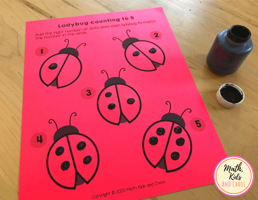 Ladybug printable on red paper with black dots added