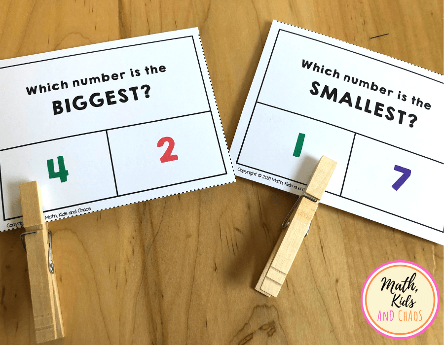 Two clip cards for comparing written numerals.